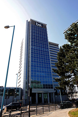 BSI Group - BSI Group headquarters building in Gunnersbury, West London, featuring the BSI Group logo