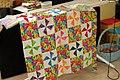 Baby quilt in pinwheel pattern.jpg