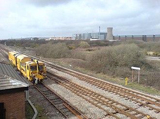Trostre Steelworks - A Network Rail train passes Llandeilo Junction on the West Wales Line/Heart of Wales Line, with Trostre steelworks in the background