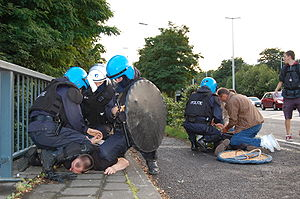 Police arrests protesters in Leuven, Belgium.