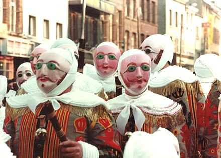The Gilles of Binche, in costume, wearing wax masks Binche - Les Gilles.jpg