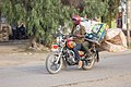 Bodaboda carrying a passanger and mattress at the same sit.jpg
