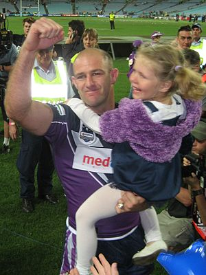 Matt Geyer - Matt Geyer with his daughter celebrating the 2007 Grand Final