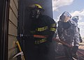 Boy Scouts of America and Fire Explorers from Post 9463 in Minot, N.D, enter the burn room insulation system.jpg