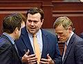 Brad Drake, Clay Ingram, and Frank White confer on the House floor.jpg
