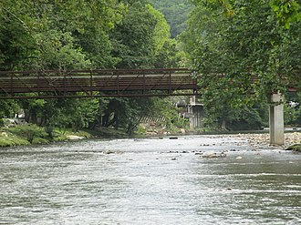 Cherokee, North Carolina - Walking bridge over the Oconaluftee River in Cherokee