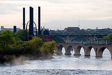 photo of the Mississippi with several bridges and the steam plant