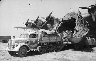 Opel Blitz - Opel ''Maultier'' towing an artillery piece onto or off an Me-323