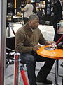 CES 2012 - NFL player Carl Banks signs at the Zeikos-iHip booth (6937782247).jpg