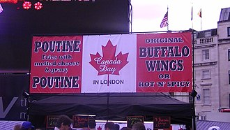 Poutine - A poutine stand sign styled as the Flag of Canada during Canada Day celebrations in Trafalgar Square, UK.