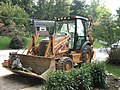 Case backhoe loader with compactors in shovel.jpg