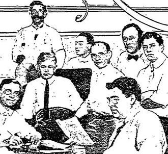 Charles S. Burnell - Assistant City Attorney Burnell in center, with glasses and looking at camera, surrounded by other lawyers who were working on a Silver Lake Park condemnation suit in 1913
