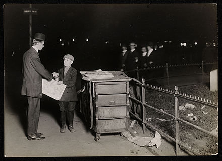 Newsies often worked late, past midnight. Above, a newsboy working in New York (1910). Child Labor in United States 1910 working night shift.jpg