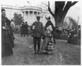 Children holding hands on the White House Lawn (1898 Easter Egg Roll).png
