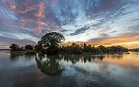 Colorful clouds and blue sky with water reflection of an island hosting trees at sunrise in Si Phan Don, Laos.jpg
