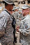 Command Sgt. Maj. Wilson Coins Soldiers in Baghdad, Iraq DVIDS178999.jpg