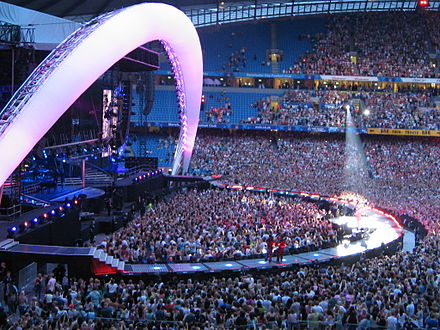 Side view of Take That on stage Coms concert.jpg