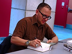 Cory Doctorow autographing a book.jpg