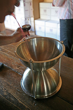 Wine tasting - Spitting into a spittoon at a wine tasting.