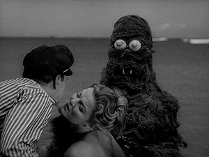 Creature from the Haunted Sea - Renzo Capetto and Mary-Belle Monahan kiss as the Creature sneaks up behind them.