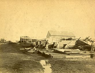 1897 cyclone, Darwin - Three men among the debris of a collapsed building after the 1897 cyclone