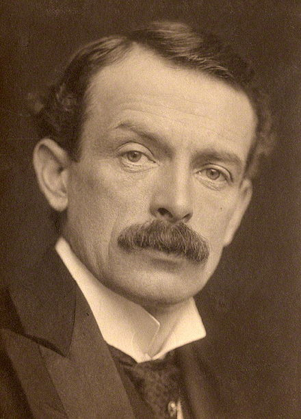 "Keynes's colleague, David Lloyd George. Keynes was initially wary of the ""Welsh Wizard,"" preferring his rival Asquith, but was impressed with Lloyd George at Versailles; this did not prevent Keynes from painting a scathing picture of the then-prime minister in his Economic Consequences of the Peace. David Lloyd George 1902.jpg"