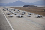 Defense.gov News Photo 111202-F-ER496-946 - F-16 Fighting Falcons from both the 8th and 419th Fighter Wings demonstrate an elephant walk formation as they taxi down a runway during an.jpg
