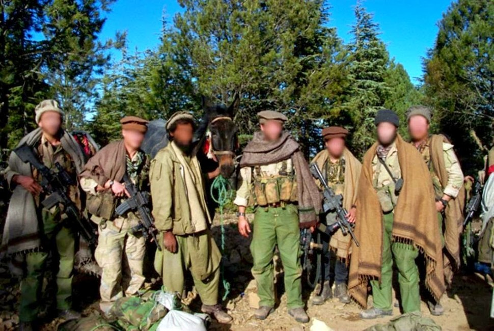 Delta force GIs disguised as Afghan civilians, November 2001 C