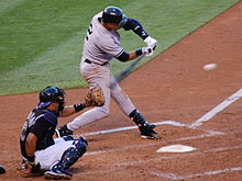 Derek Jeter swings at a pitch
