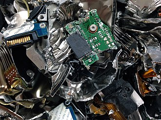 Data remanence - The pieces of a physically destroyed hard disk drive.