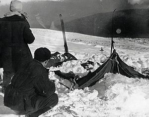 Dyatlov Pass incident - A view of the tent as the rescuers found it on February 26, 1959: the tent had been cut open from inside, and most of the skiers had fled in socks or barefoot
