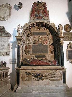George Carew, 1st Earl of Totnes - Monument to George Carew, Earl of Totnes (d. 1629) and his wife Joyce Clopton (d. 1637) in the Clopton Chantry Chapel in the Church of the Holy Trinity, Stratford-upon-Avon. His funeral helm hangs from the wall above left