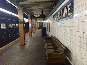 Elmhurst Avenue (IND Queens Boulevard Line) - Manhattan bound platform with mosaic.