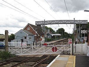 Elsenham railway station - The pedestrian level crossing with the new footbridge added in 2007