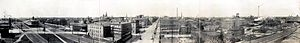 Erie, Pennsylvania - Panorama of downtown Erie in 1912, looking West along the 15th Street tracks. The tallest steeple to the north of the tracks is St. Peter Cathedral