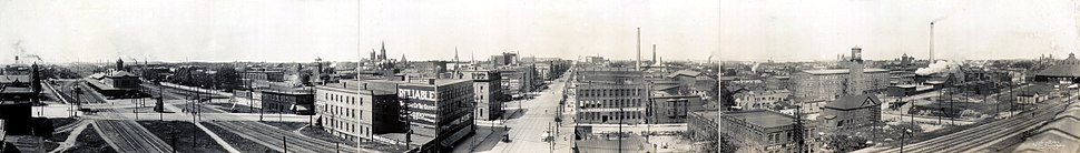 Panorama of downtown Erie in 1912, looking West along the 15th Street tracks. The tallest steeple to the north of the tracks is St. Peter Cathedral