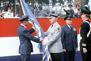 Richard H. Ellis - Richard H. Ellis, incoming commander, receives the NATO flag from GEN Ernst Ferber, German Army, as GEN John W. Vogt, outgoing commander, stands by during the Allied Air Force Central Europe (AAFCE) change of command. 1975.