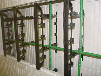 Insulating concrete form - This insulated concrete form is cut away to show the inner structure of the formwork and the reinforcing bar (rebar). The cavity is filled with concrete to create the permanent wall.