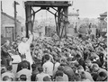Father (Major) Edward J. Waters, Catholic Chaplain from Oswego, New York, conducts Divine Services on a pier for... - NARA - 531190.tif