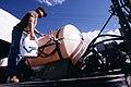 Filling sprayer tank on tractor with Banvel (1985).jpg