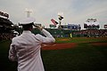 Flickr - Official U.S. Navy Imagery - A Sailor flies an American flag during the opening ceremonies for a Boston Red Sox game at Fenway Park..jpg