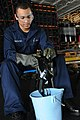 Flickr - Official U.S. Navy Imagery - Sailor cleans a gas mask in the hangar bay aboard USS George H.W. Bush.jpg
