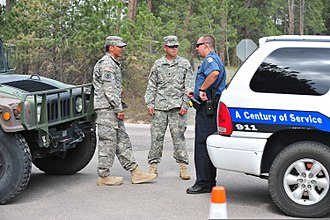 Colorado Army National Guard - Colorado National Guardsmen assist law enforcement in providing security for evacuated homes during a forest fire.
