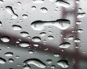 The Golden Gate Bridge refracted in rain drops...