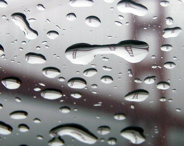 Golden Gate  bridge seen through a window on a rainy day