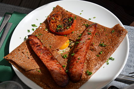 Galettes served with eggs and sausages.