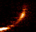 Gas cloud being ripped apart by the supermassive black hole at the centre of the Milky Way.jpg