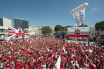 Thousands of Gibraltarians dress in their national colours of red and white during the 2013 Gibraltar National Day celebrations. Gibraltar National Day 027 (9719742224) (2).jpg