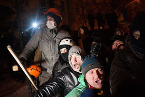 Groups of protesters face a deployment of riot police during the evacuation operations. Kiev. December 10, 2013.jpg