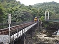 Guanpu Suspension Bridge and TRA Pingxi Line railway bridge 20141016a.jpg